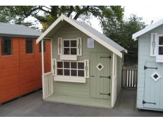 This Pine Lodge is painted in Leafy Herb & Fresh Cream